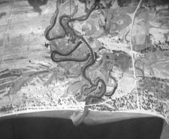 Aerial photo of the Okanagan River where it drains into the north end of Skaha Lake, taken in 1949.